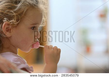 Little Girl Eating A Pink Lolly Pop