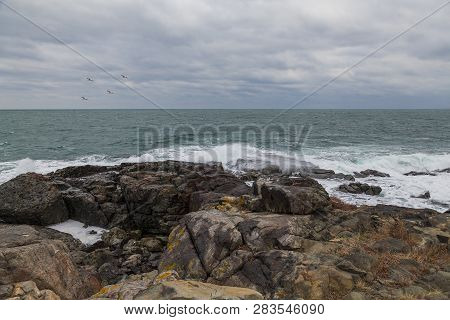 Sea ​​scenery In Dramatic Weather In The Blue Hour. A Landscape With Dramatic Clouds And Stormy Wate