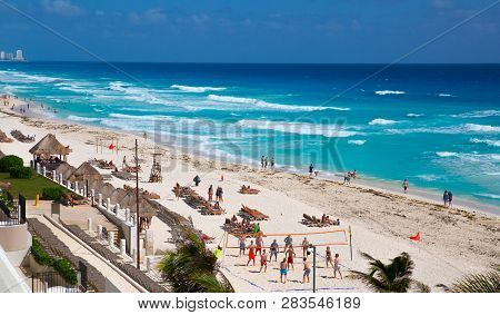 Mexico, Cancun - February 15, 2018: People Relaxing And Sunbathing On The Beach. Cancun Grand Pyrami