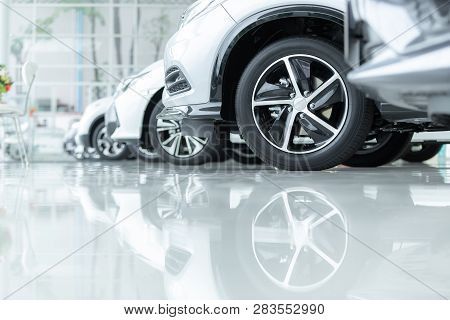 Cars For Sale, Automotive Industry, Cars Dealership Parking Lot. Rows Of Brand New Vehicles Awaiting