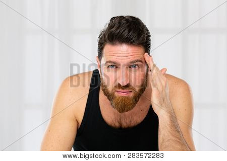 Handsome middle aged bearded man. Skin care