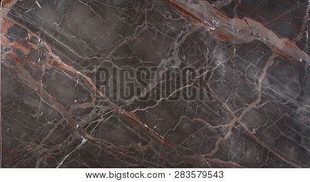 Marble Slab Brown With Pink And Red Stripes Is Called Caravaggio