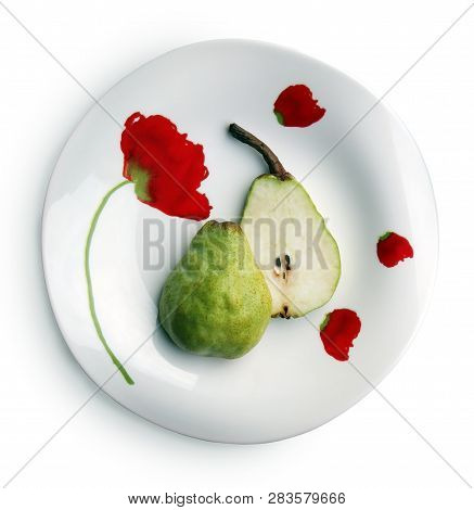 Still Life With Two Halves Of Sweet Ripe Pear  On The Beautiful Plate Against White Background. Sele