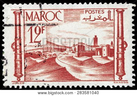 Luga, Russia - January 24, 2019: A Stamp Printed By Morocco Shows View Of Marrakesh City, Circa 1948