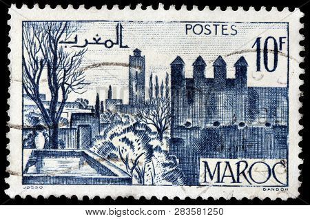 Luga, Russia - January 24, 2019: A Stamp Printed By Morocco Shows View Of Fez - The Second Largest C