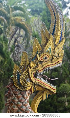This Wat Chedi Liam Dragon stands in the ancient city of Wiang Kum Kam just south of Chiang Mai, Thailand. poster
