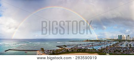 Beautiful Double Rainbow Over Honolulu Harbor With Skyline Of Honolulu And The Pacific Ocean.