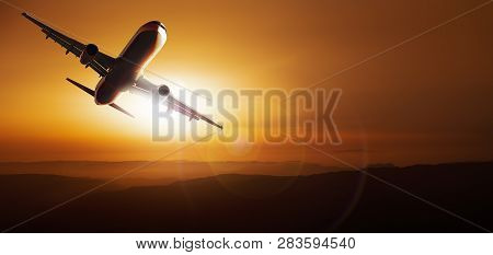 Modern Aircraft Is Flying Against A Sunset
