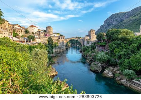 Neretva River With The Old Bridge In The Background In Mostar, Bosnia And Herzegovina