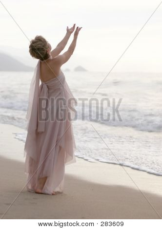 Praying Woman On The Beach