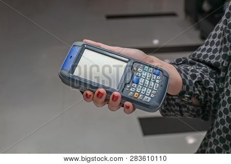 Woman Using Portable Barcode Scanner And Rfid Reader Device