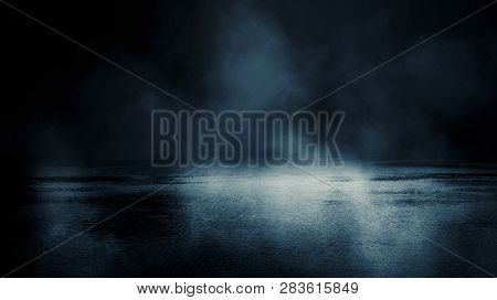 Background Scene Of Empty Street. Night View Of The River, The Night Sky With Clouds, The Reflection