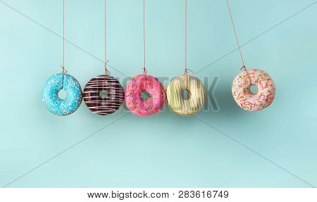 Newtons Cradle From Doughnuts. Collision Balls Made From Donuts. Harm Of Sugar, Donuts Time Or Healt