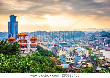 Keelung, Taiwan cityscape and temples at dusk.