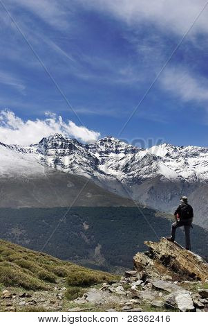 Male standing on top of spanish hightes mountain
