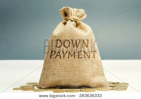 Money Bag With The Word Down Payment. Payment Used In The Context Of The Purchase Of Expensive Items