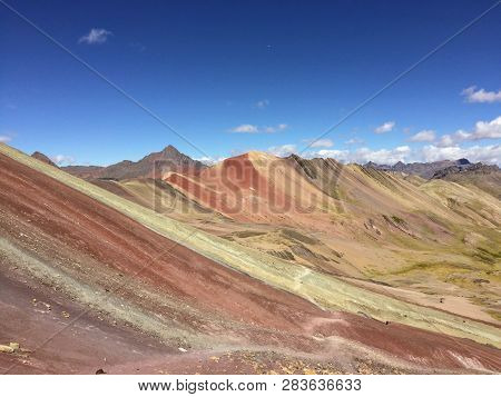 A Unique And Interesting View Of Rainbow Mountain, An Incredible Mountain In Peru.  Red Areas Are Du