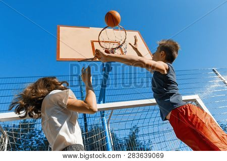 Streetball Basketball Game With Two Players, Teenagers Girl And Boy With Ball, Outdoor City Basketba