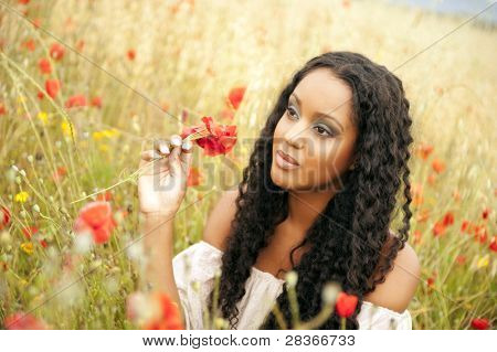 Young african woman picking flowers