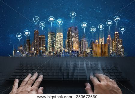 Computer Networking And Internet Connection. Hand Typing Computer Keyboard And Buildings With Social