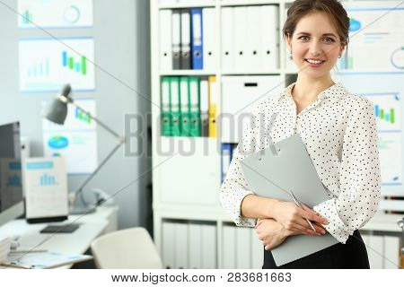 Adult Caucasian Fashion Attractive Businesswoman Smile Workplace Background Loock At Camera. Hold On