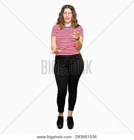 Young beautiful woman wearing glasses disgusted expression, displeased and fearful doing disgust face because aversion reaction. With hands raised. Annoying concept.