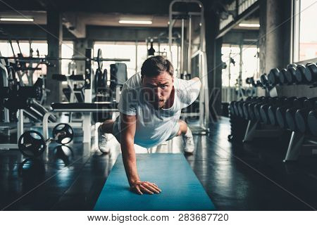 Sporty Man Push-up Exercising By One Hand In Fitness Gym., Portrait Of Young Handsome Man Working Ou