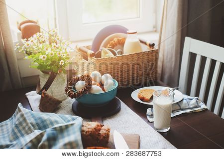 Country Breakfast On Rustic Home Kitchen With Farm Eggs, Butter, Wholegrain Bread And Milk. Organic