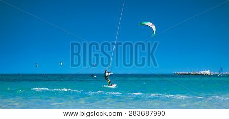 Egypt, Hurghada - 30 November, 2017: The kiter gliding over the Red sea surface. The amazing panoramic view. The lone sportsman among the calm sea water. The outdoor activity. Extreme sport.