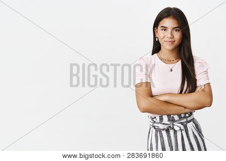 Studio Shot Of Assertive And Self-assured Good-looking Young Adolescent Girl In Skirt And Blouse Hol