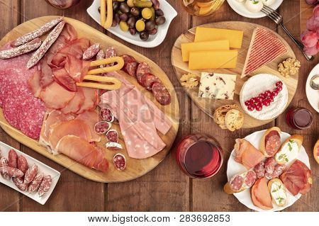 Charcuterie Tasting. A Photo Of Many Different Sausages And Hams, Deli Meats, And A Cheese Platter,