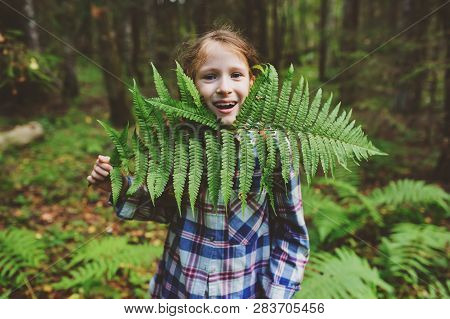 Happy Kid Girl Exploring Summer Forest, Traveling On Vacation. Teaching Kids To Love Nature. Earth D