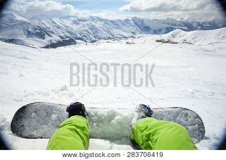 One Snowboarder With Snowboard On Winter Mountain