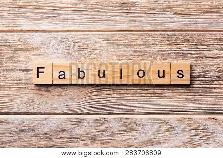 Fabulous Word Written On Wood Block. Fabulous Text On Wooden Table For Your Desing, Concept