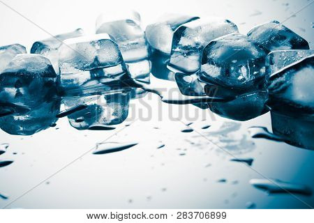 Pieces Of Melting Ice On The Table