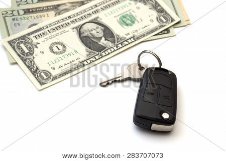 Isolated Black Car Key And A Bunch Of Banknotes Of American Dollars. Concept Of Purchase, Rental, Le