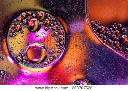 Oil Drops On A Water Surface Abstract Background. Art Bubble