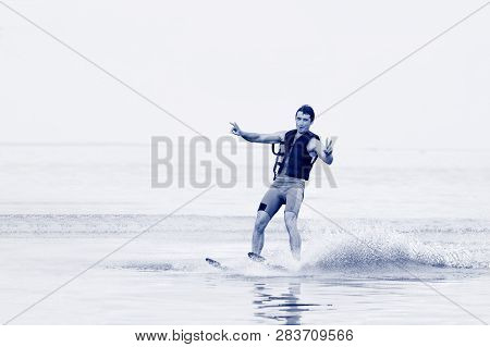 Happy Man Waterskiing And Having Fun. Living A Healthy Lifestyle And Staying Active. Doing Water Spo