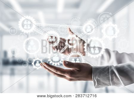 Business Woman In White Shirt Keeping White Social Gear Icons In Hands With Office View On Backgroun
