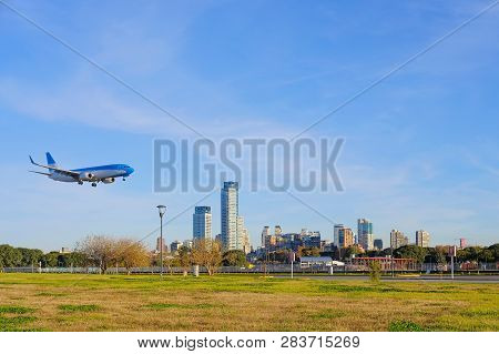 Airplane Landing In Buenos Aires At The City Center Airport, Skyscrapers Of The Modern Business Dist