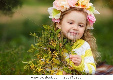 Beautiful Little Girl Outdoors In A Blooming Spring Garden On A Sunny Day.little Girl In Sunny Sprin