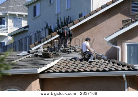 Hispanic Roofer Laying Roofing Tile