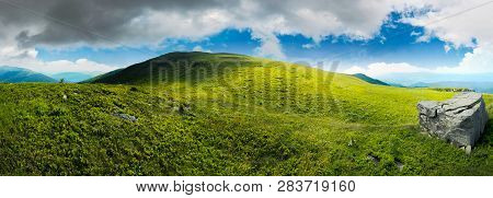 Panorama With Rock On The Grassy Hill In Mountains. Beautiful Summer Landscape. Idyllic Nature Scene