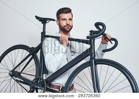 Best Transport. Close Up Photo Of Good Looking Man In Casual Clothes Carrying His Bicycle. Urban Sty