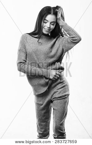 Fashionable knitwear. Female knitwear. Knitwear concept. Feel warm and comfortable. Woman wear grey textile suit blouse and pants. Warm comfortable clothes. Casual style fashion for every day poster