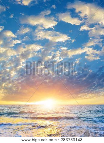 Seascape With Rising Sun Above The Summer Sea.breathtaking View Of Heaven At Sunrise In High Summer.