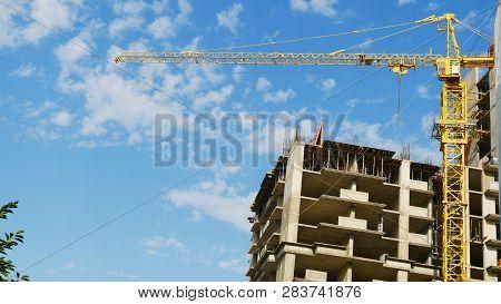 Construction Crane Near The Building Under Construction