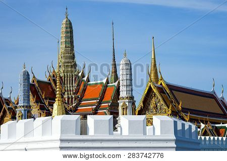 Temple of the Emerald Buddha or (Wat Phra Keaw) on daytime, the old temple, built in the 2325 as enshrined the statue of the Emerald Buddha, and is also a landmark for tourists, Bangkok, Thailand poster