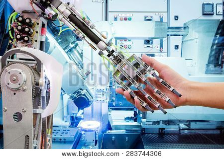 Artificial Intelligence Handshake With Humans On Industrial Robotics In Blue Tone Color Background,