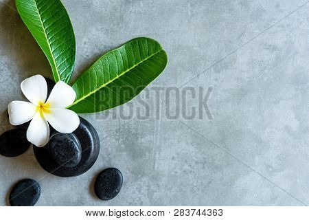 Thai Spa.  Top View Of White Plumeria Flower Setting For Massage Treatment And Relax On Concrete Bla